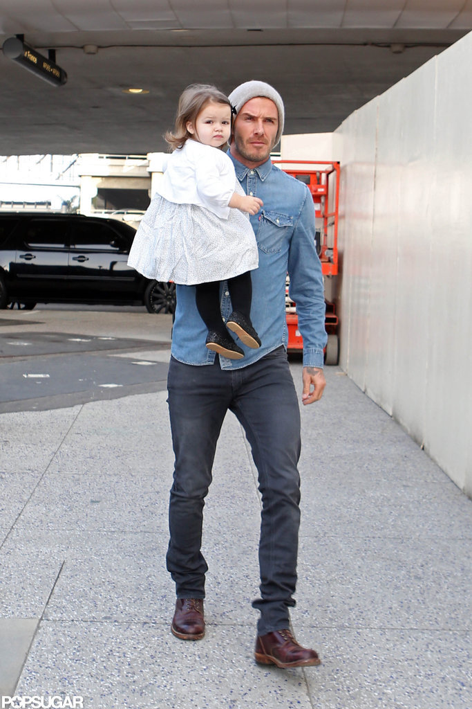 David Beckham carried Harper into LAX.