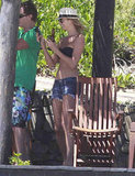 Stacy Keibler topped her bikini with denim shorts and a straw hat during a vacation in Mexico in March 2012.