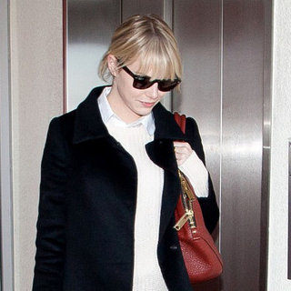 Emma Stone Arriving at LAX in Red Pants | Pictures