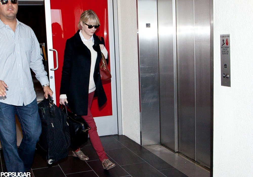 Emma Stone arrived in LA after a trip to NYC.