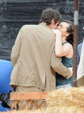 Milla Jovovich and her husband, Paul W.S. Andersen, got affectionate in LA in October.