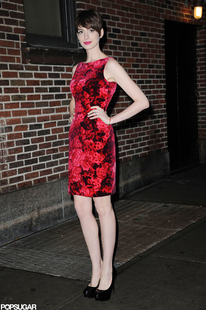 Anne Hathaway wore a red floral dress.