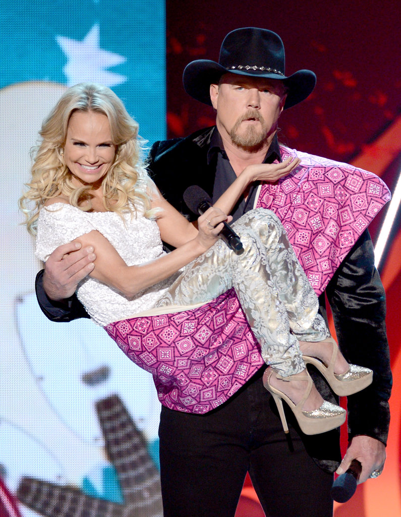 Kristin Chenoweth was carried on stage by Trace Adkins.