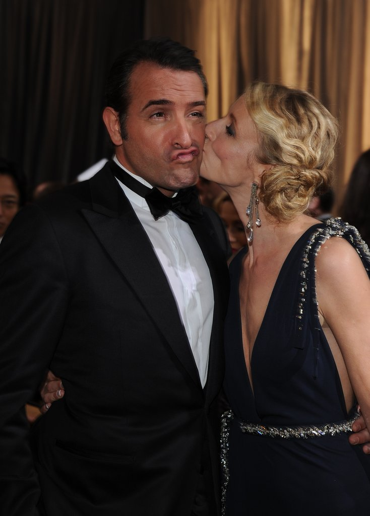 Prior to winning the best actor Oscar, The Artist's Jean Dujardin shared a kiss with his wife, Alexandra Lamy, upon arriving at February's Academy Awards ceremony.