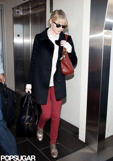 Emma Stone matched her purse to her pants at LAX.