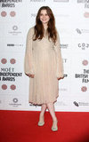 Alice Englert smiled on the red carpet.