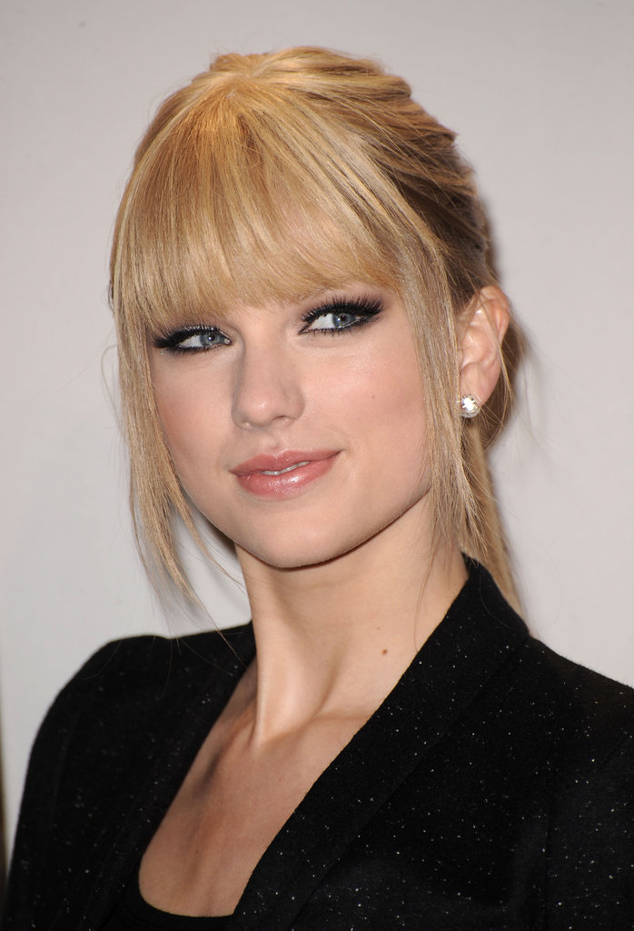 Trading in her curls for seriously straight strands, Taylor was almost unrecognizable at the 2010 American Music Awards. It was the first time she hit a major red carpet with straight hair and bangs. Plus, she amped up the edge factor with dark, smoked-out eyes and a nude lip.