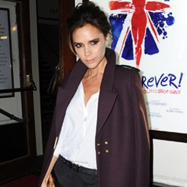 Victoria Beckham Wearing Long Purple Coat
