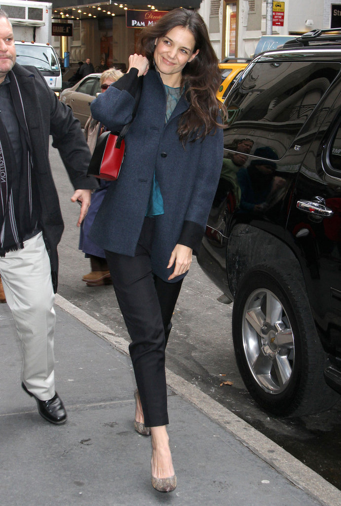 Katie Holmes was all smiles in NYC earlier today.