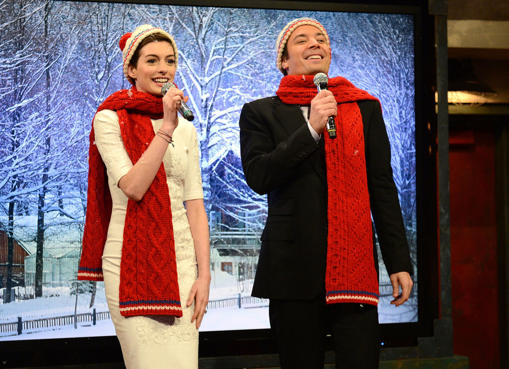 Anne Hathaway and Jimmy Fallon joked around while singing holiday carols.