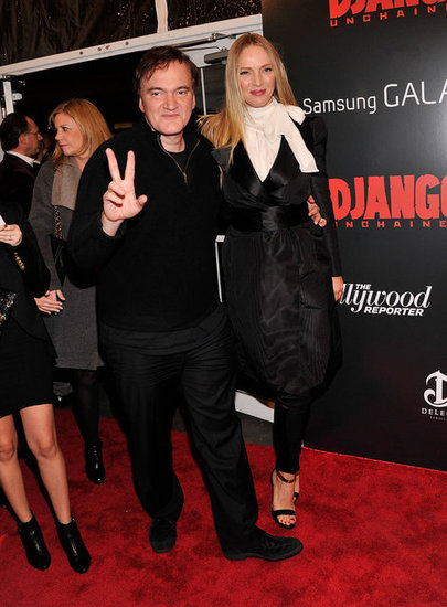 Uma Thurman hit the red carpet with Quentin Tarantino in a black wrap coat, white bow blouse, trousers, and gold ankle-strap sandals.