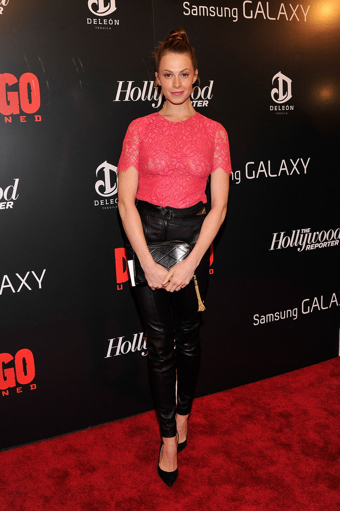 Elettra Wiedemann showed off her supermodel legs in high-waisted leather pants paired with a pink semi-sheer lace top for a slick and sexy look.