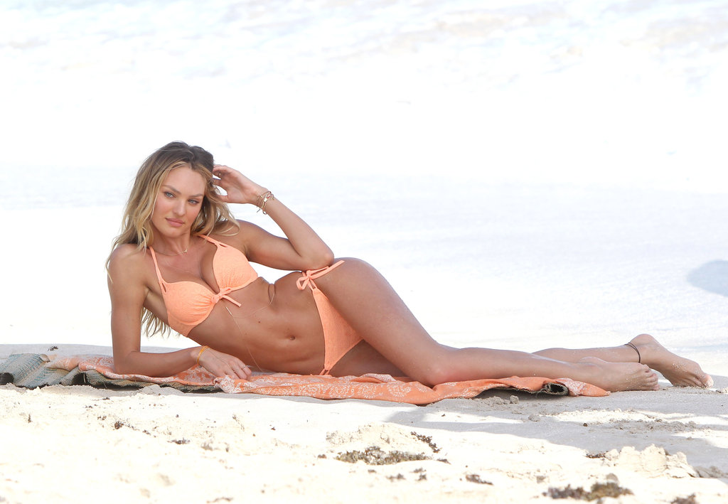 Candice Swanepoel showed off an orange bikini.