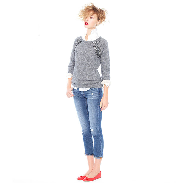 Sometimes all you need to dress up denim are a little embellishment and a pair of pretty shoes. Fiery ballet flats provide the perfect pop of red, while a sweatshirt finished in a little sparkle means this isn't just a denim look, it's a denim look you can confidently wear out to a laid-back holiday dinner, brunch, and beyond.