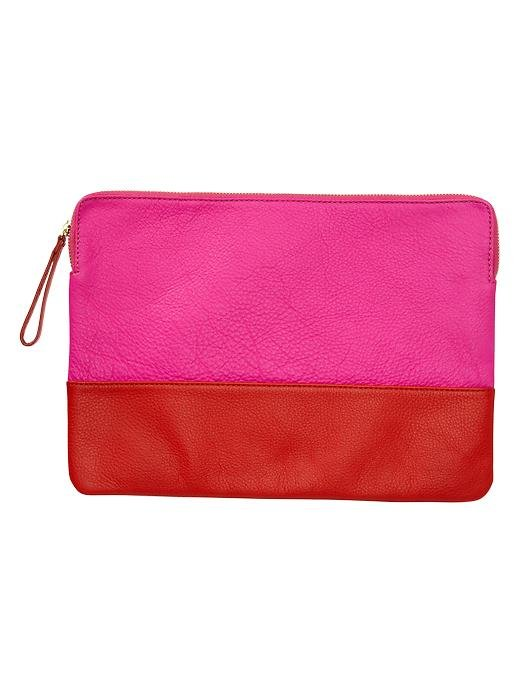 She can use this two-toned leather clutch ($40) as a purse, a makeup bag, or a pouch for smaller items inside her larger tote.