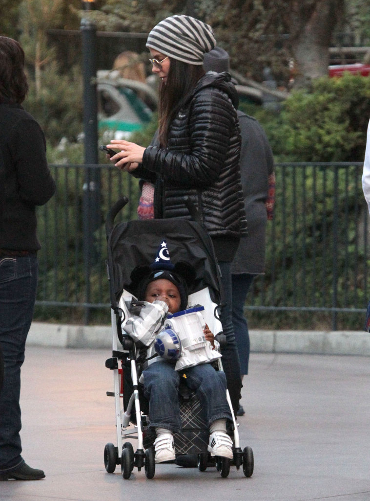 Sandra Bullock pushed Louis around Disneyland.