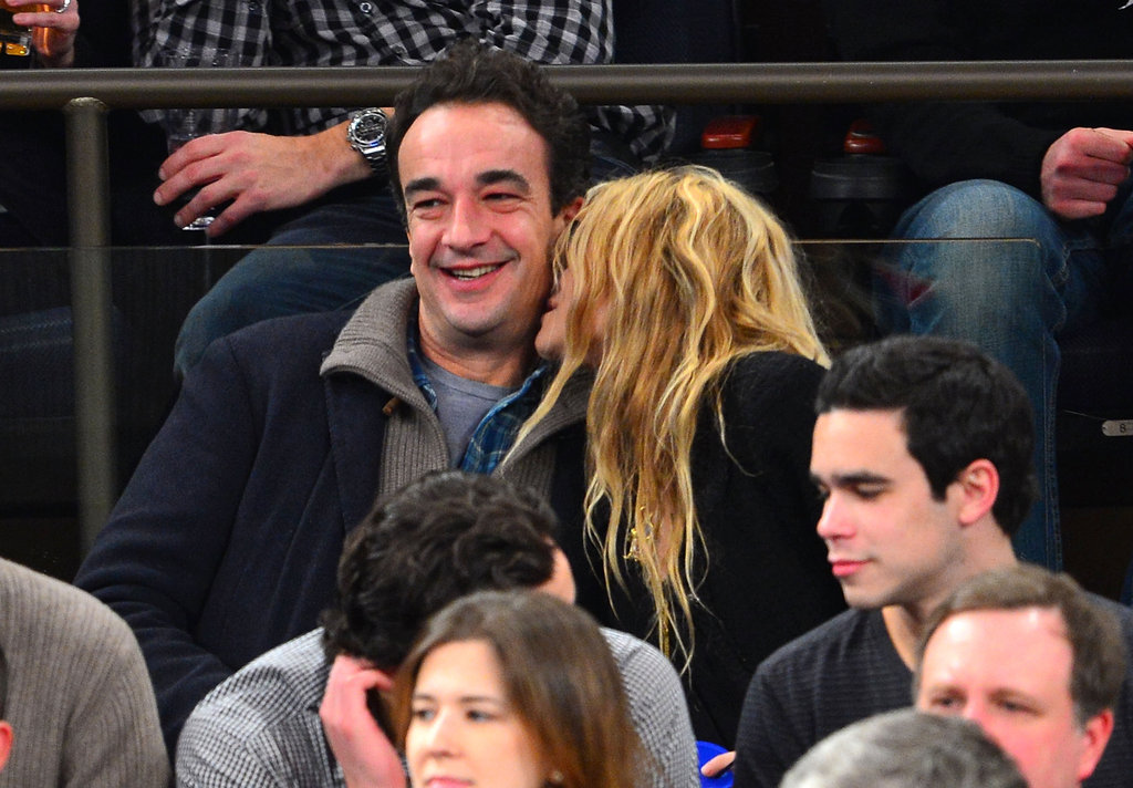 Mary-Kate Olsen kissed her boyfriend Olivier Sarkozy.