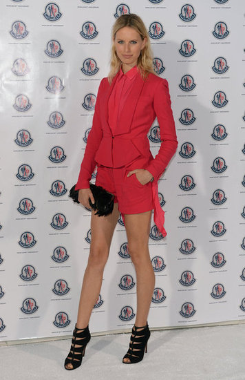 Karolina Kurkova showed off her stems at Art Basel in a brilliant, magenta-hued short and blazer set by Elie Saab.