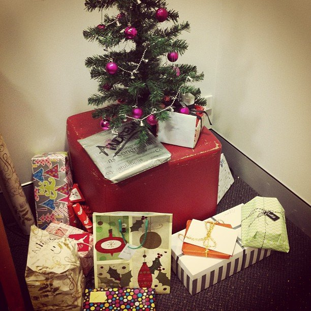 The mini Christmas tree is home to all our office kris kringle pressies . . . but not for long!
