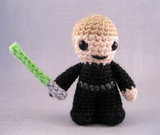 As a Jedi, Luke Skywalker ($4) dons a black robe and green lightsaber.
