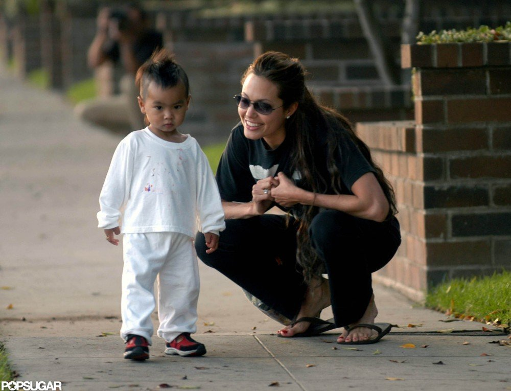 Angelina Jolie got down on Maddox's level in LA in September 2003.
