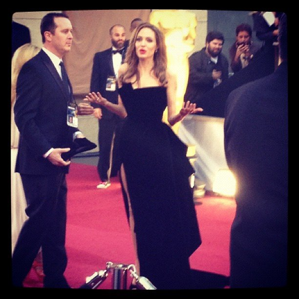 Angelina Jolie, in her now-infamous dress, couldn't seem to find her date, Brad Pitt, at the Oscars.