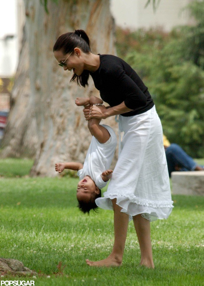 Angelina Jolie monkeyed around with Maddox in Santa Monica, CA, in July 2002.