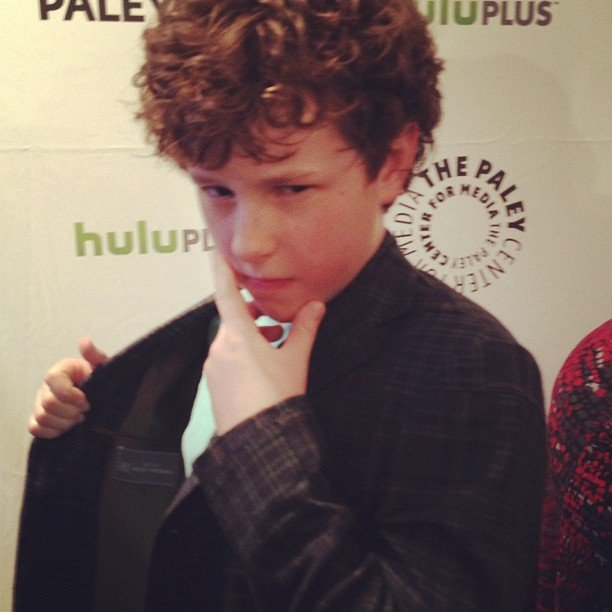 Modern Family's Nolan Gould happily posed for a photo during PaleyFest upon our request.