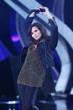 Demi Lovato posed onstage.