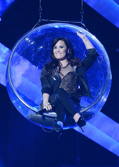 Demi Lovato entered the stage in a floating bubble.