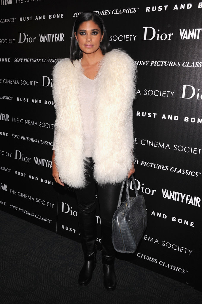 Rachel Roy added textural intrigue to her leather leggings with a plush, white furry vest.