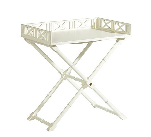 The bamboo legs of this White West Indies Tray Table ($599) add a modern, island look while the white color keeps this table crisp — a great piece for a home cocktail bar.