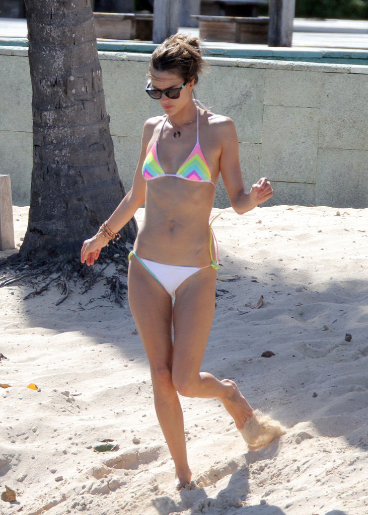 Alessandra Ambrosio walked in the sand.