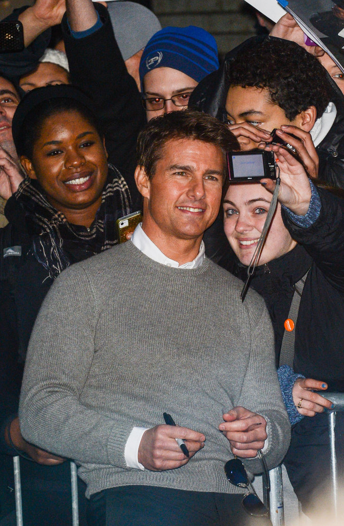 Tom Cruise took photos with fans.