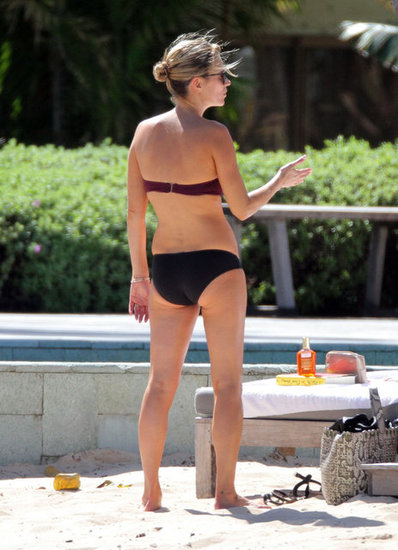 Kate Moss wore a black and burgundy bikini.