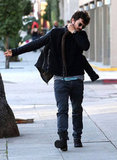 Orlando Bloom slipped back into his jacket.