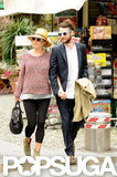 Sienna Miller walked with Tom Sturridge in Portofino, Italy, in May.
