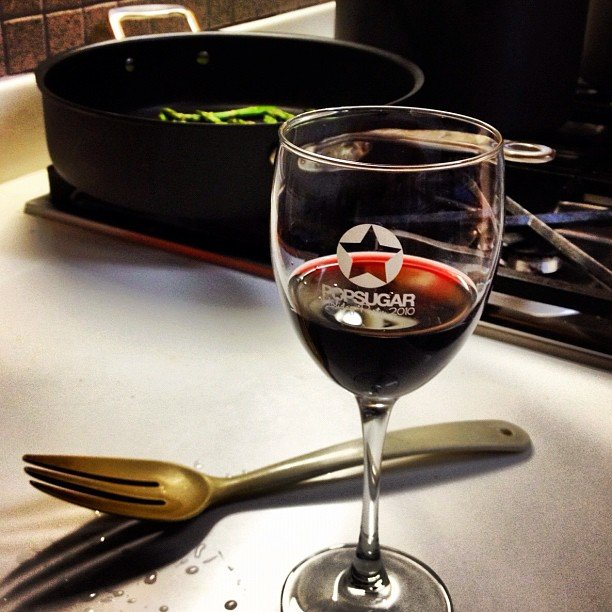 "The perfect end to a day: a glass of wine — in a ""vintage"" PopSugar wine glass, of course."