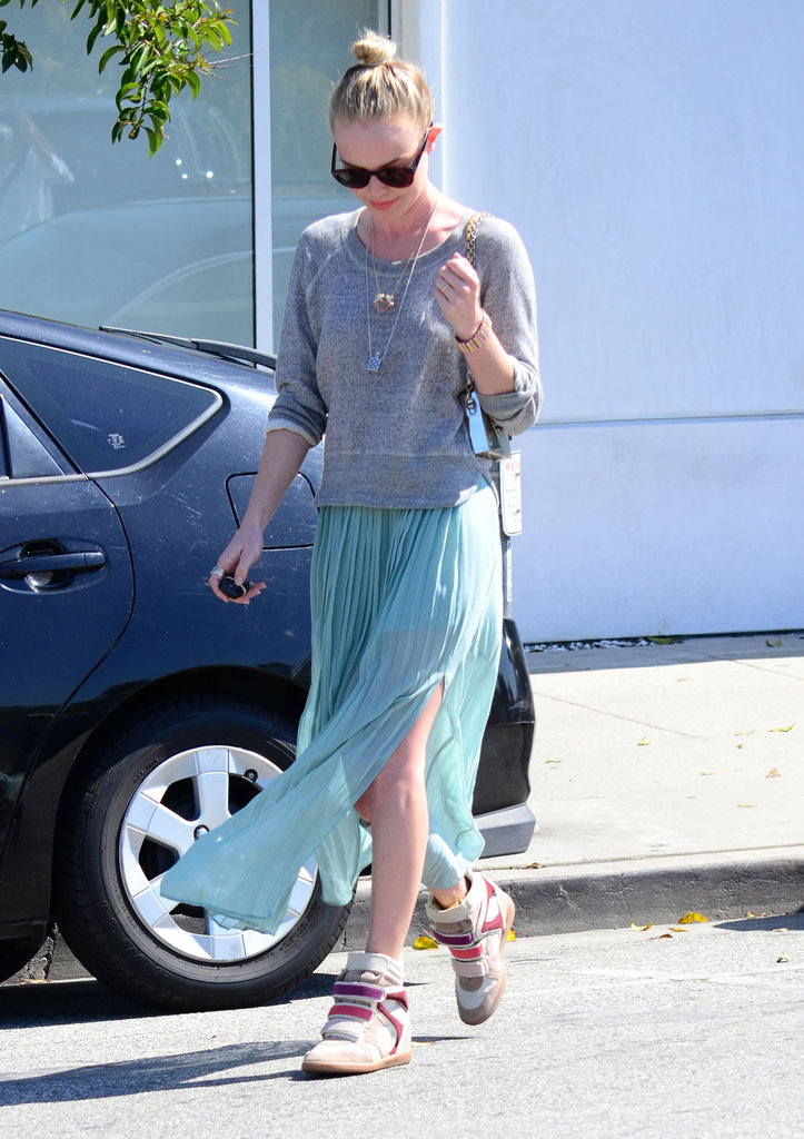 Kate Bosworth showed off her summertime style earlier in the year with a flowy maxi, a slouched sweatshirt, and tri-color Isabel Marant sneakers.