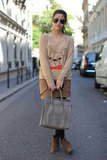 We dig the monochromatic feel here, especially that beige Céline tote and her adorable bulldog sweater.