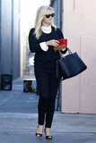 Reese Witherspoon got her wallet out of her bag.