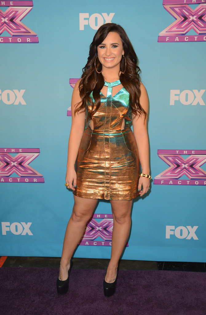 Demi Lovato posed on the red carpet during the finale.