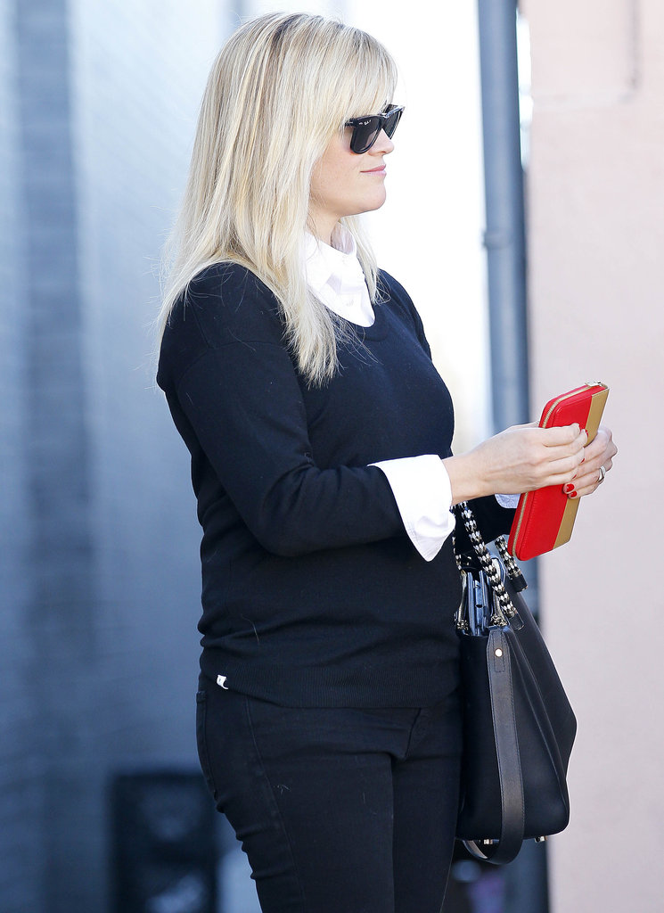 Reese Witherspoon got her red wallet out of her purse.