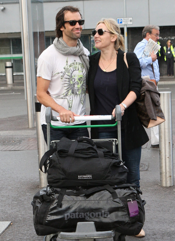 Kate Winslet and Ned Rocknroll had the look of love in October 2011 at London's Heathrow Airport.