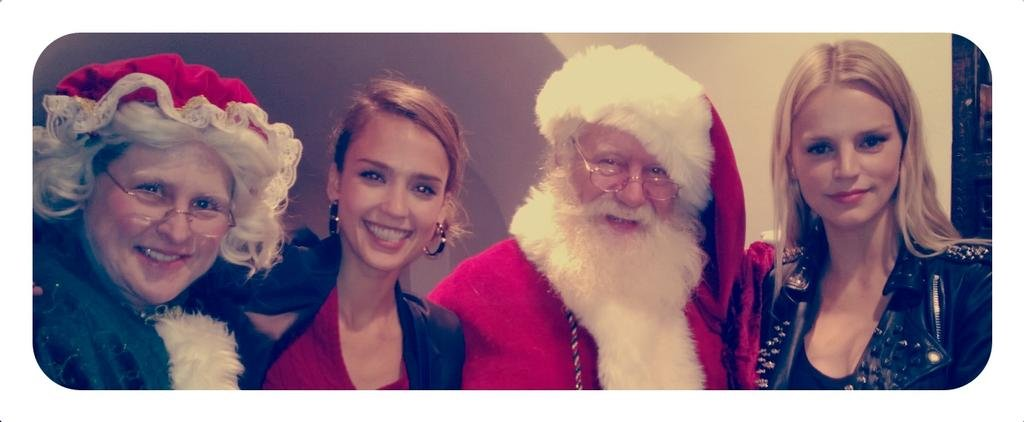 Jessica Alba posed for Christmas photos with Santa, Mrs. Claus and friend Kelly Sawyer. Source: Twitter user jessicaalba