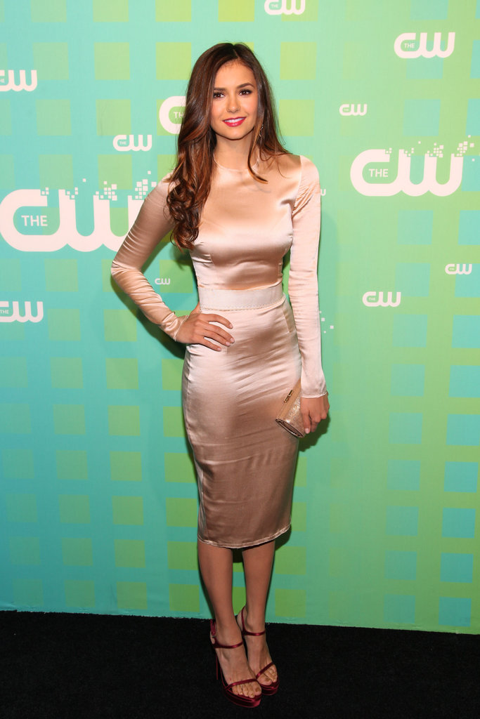 Nina flaunted her form in a curve-conscious nude sheath.