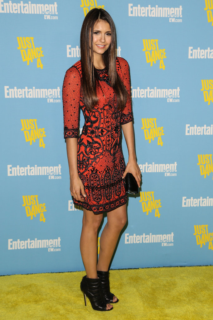 Nina added interest to an already intricately adorned Jenny Packham mini with a pair of open-toe Jimmy Choo booties.