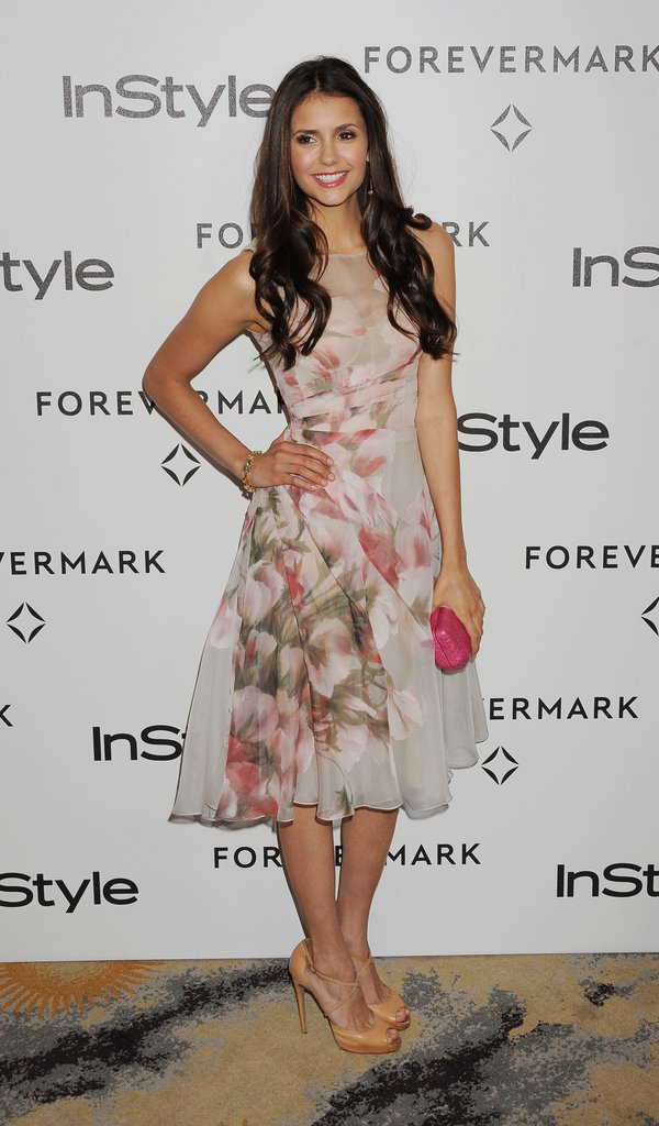 Nina got girlie in this floral fit-and-flare Monique Lhuillier confection.