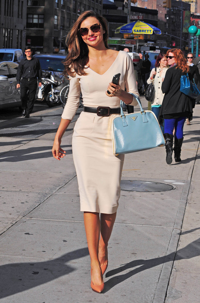 Miranda put a modern spin on classic style — looking glamorous as ever — in a cream-colored Victoria Beckham dress accessorized with a light-blue Prada tote, Lanvin heels, and Miu Miu sunglasses.