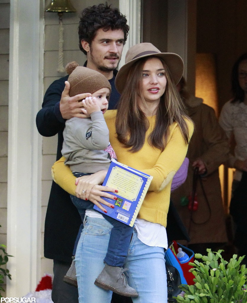 Orlando Bloom, Miranda Kerr, and Flynn Bloom left a party.